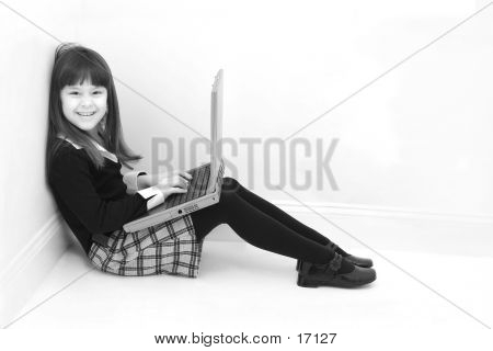 Child Using Laptop In Black & White