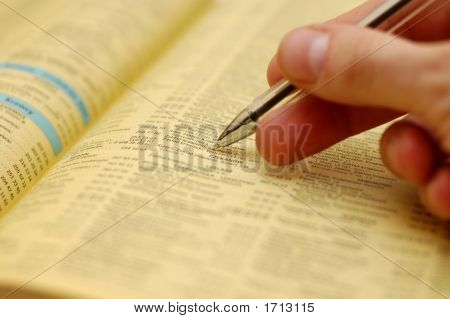 Hand And Phone Book