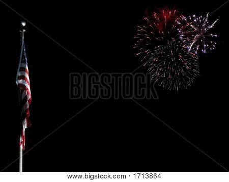 Us Flag Lit Up With Fireworks