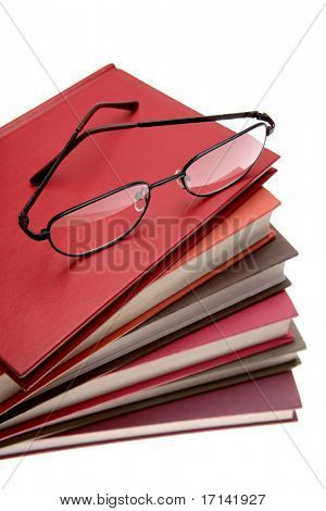 Reading glasses on pile of books
