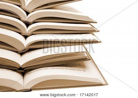 Pile of books over white