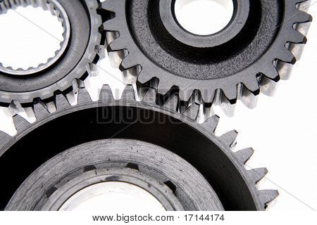 Closeup of three gears over white