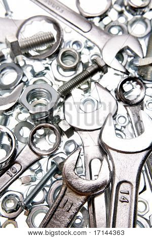 Spanners, nuts and bolts on white