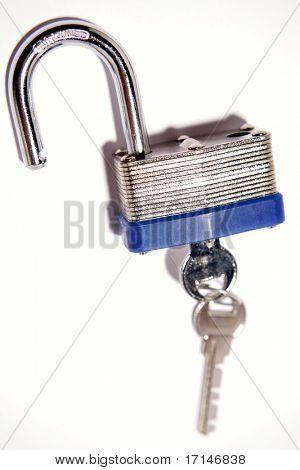 Open padlock and keys over white