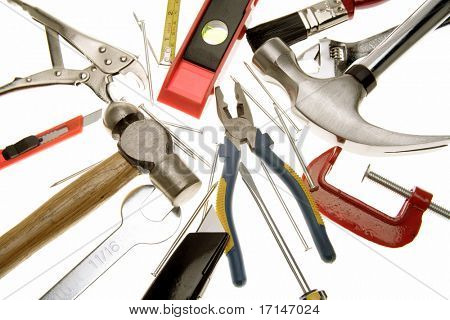 Assortment of tools over white
