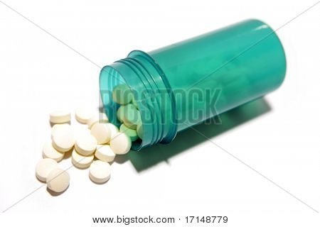 Pills spilling from plastic container isolated on white background