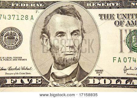 Detalle de billetes de cinco dólares americanos