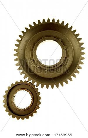 Two gears meshing together over white