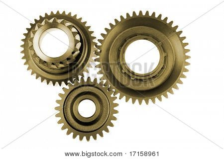 Three gears meshing together over white