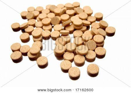Vitamin C tablets over white background