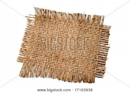 Piece of frayed burlap on white