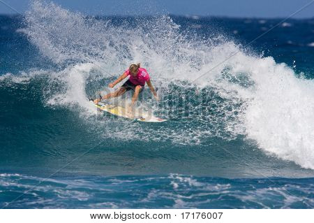 MAUI, HAWAII - DECEMBER 18, 2008:   Professional surfer Stephanie Gilmore does a huge power turn during the Billabong Pro Maui - December 18, 2008 in Maui, HI.