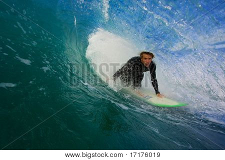Pro Surfer In Blue Tube