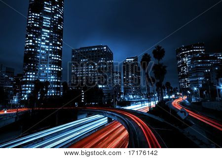 Urban City with Freeway Overpass Traffic, and Night Skyline,