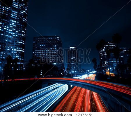 Modern Urban City with Freeway Traffic at Night, Dark City Skyline, Down Town Los Angeles