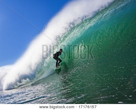 Surfer on a  Big Beautiful Wave in an Epic Tube