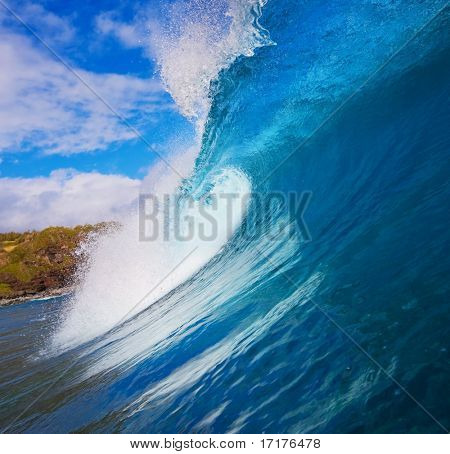 Beautiful Large Surfing Wave Breaks in Ocean with Sunny Blue Sky, Surfers view from water level inside the Tube