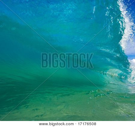 Crystal Clear Aqua Blue Wave Breaks in Ocean, Perspective from Water Level inside the Tube