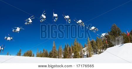 Sequence of a Skier doing a Radical Back flip on a Sunny Day at a Ski resort