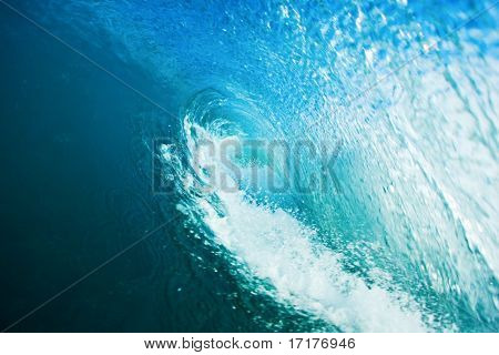 In the Tube of a Perfect Blue Surfing Wave