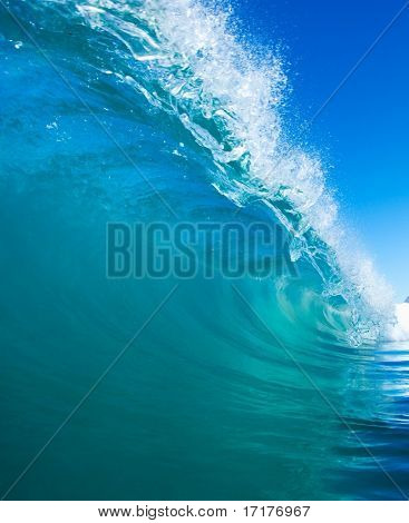 Perfect Blue Surfing Wave breaks in Tropical Ocean