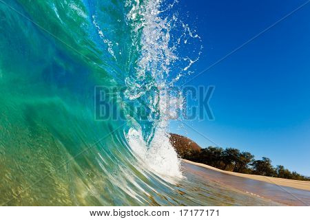 Beach Wave, view in the tube with beach in background
