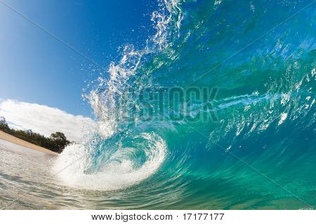 Beautiful Blue Ocean Wave breaking on Sunny Beach