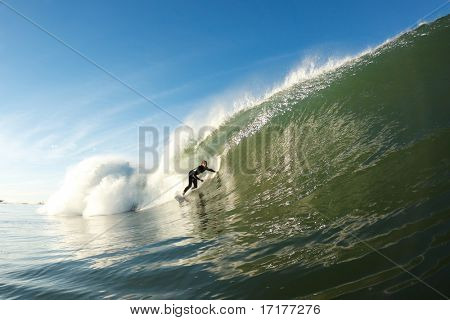 Surfer riding Large Wave