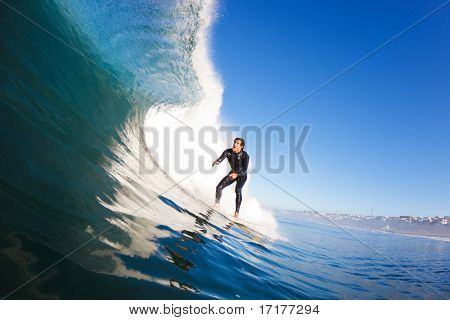 Surfer riding Large Blue Wave