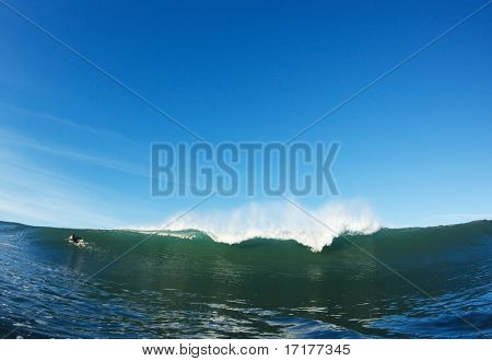 Surfer Paddling Over Ocean Wave, View from Water Level