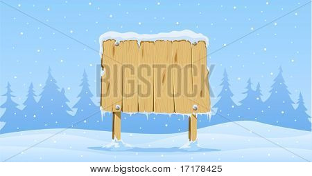 wooden blank board in snow on winter background with fir-trees
