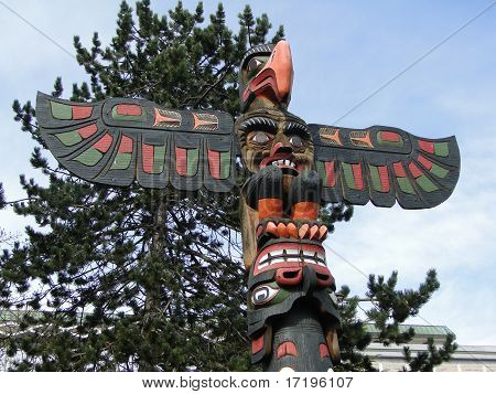 Totem Pole Topped  By Thunderbird