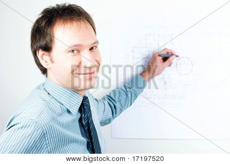 Young Man Architect Presenting A Project