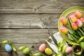 Easter table setting with spring tulips and cutlery. Holidays background poster