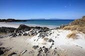 picture of eigg  - Remote isolated sandy beach with views to the Isles of Eigg and Rum - JPG