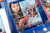 Young woman, schoolgirl print 3D model on 3D printer poster