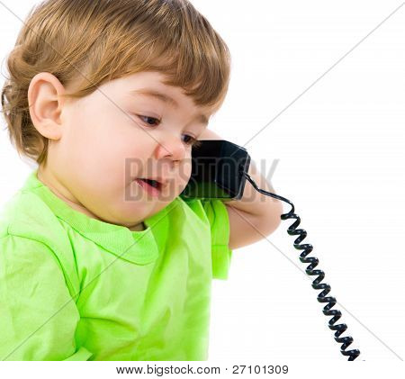 Little boy with the phon