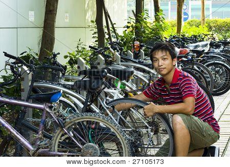 asia boy fix his bike