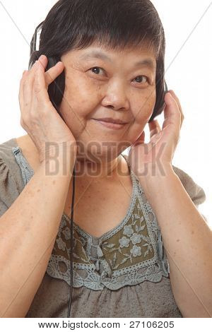 Senior woman listening to music with headphones