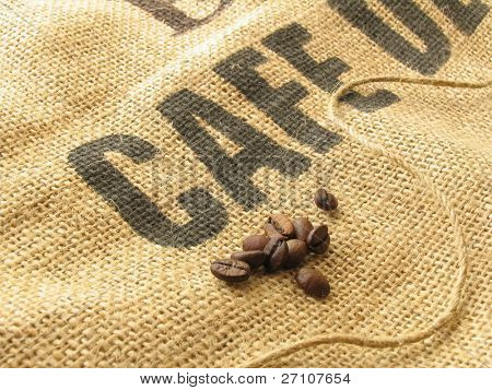 "Coffee Seeds On Sackcloth With Printed Word ""Cafe"""