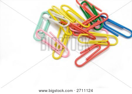 Multicolored Paper-Clip On The White Isolated Background