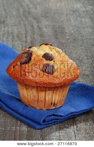 closeup banana chocolate muffin with napkin
