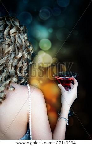 Young woman with martini glass