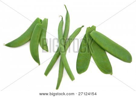 Pea vegetables in pods with french green beans and mangetout, isolated over white background.