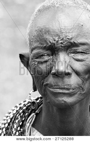 AFRICA, KENYA, SUMBURU - NOVEMBER 8: Portrait of the oldest lady in Sumburu tribe, review of daily life of local people, near Sumburu Park National Reserve, November 8, 2008, Kenya