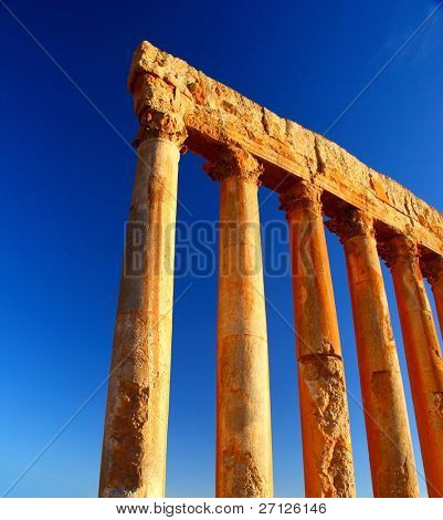 Jupiter's temple ancient Roman columns over blue sky, Baalbek, Lebanon