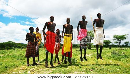 KENYA, AFRICA - NOVEMBER 8: African warriors dance in traditional jumps as a cultural ceremony, typical daily life of local people, near Samburu National Park Reserve, on November 8, 2008 in Kenya, Africa