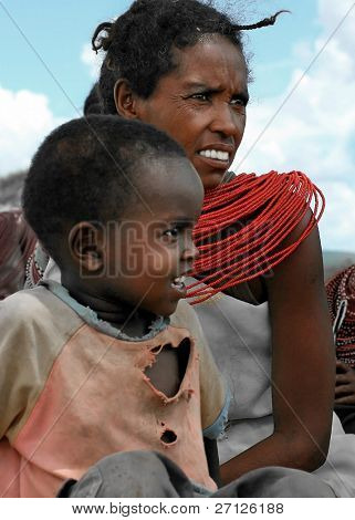 KENYA, AFRICA - NOVEMBER 8: A woman with her child, typical daily life of local people, near Samburu National Park Reserve, on November 8, 2008 in Kenya, Africa