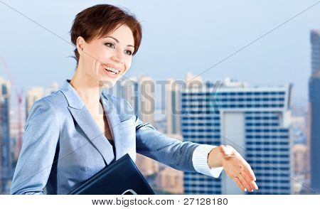 Successful businesswoman making a deal, young smart office worker, woman over blue sky & city background, handshake, business lifestyle concept
