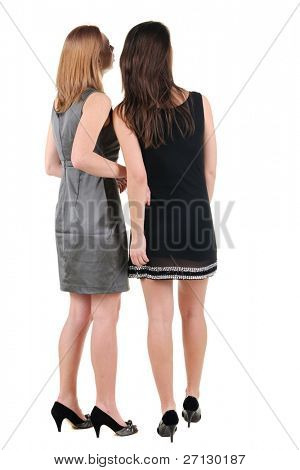 The back of two beautiful young woman l. Rear view. Isolated over white.